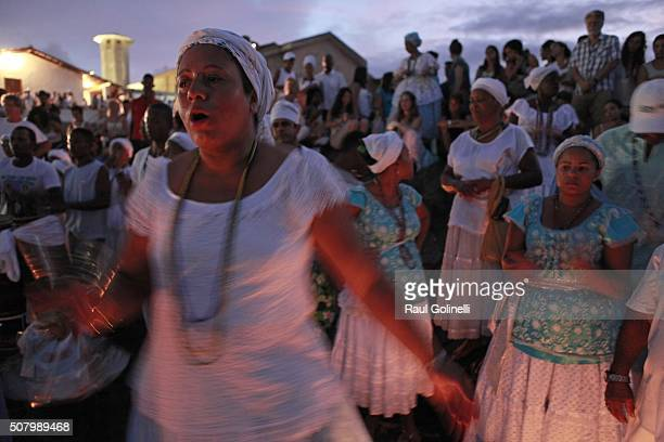 Women sing and dance at Rio Vermelho beach to celebrate Yemanja day on February 2 2016 in Salvador Brazil Yemanja is a powerful goddess of the sea in...