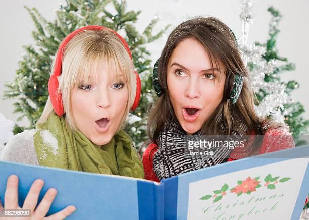 Women singing Christmas carols