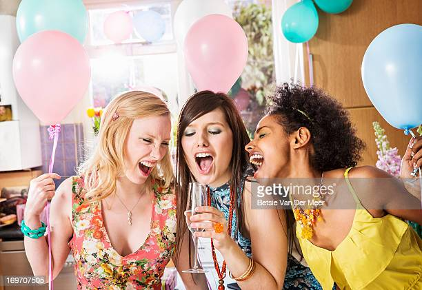 women singing using glass as microphone. - birthday stock pictures, royalty-free photos & images