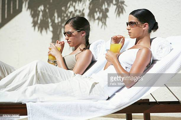 Women sipping orange juice at a spa