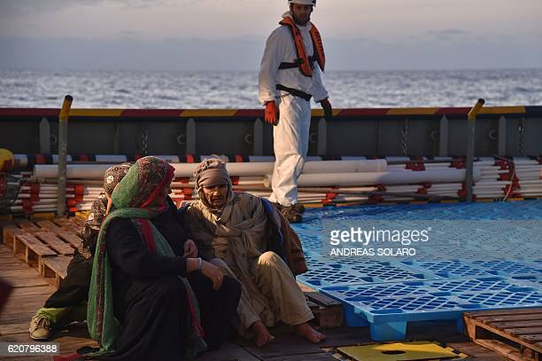 Women sit aboard the rescue ship Topaz Responder run by Maltese NGO Moas and Italian Red Cross during a rescue operation of migrants and refugees off...