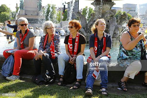 5 women sit around a fountain at the Schloßplatz waiting for the opening service to start Tens of thousands of people attended the opening services...