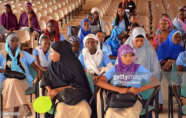 Women sit as they gather on May 8 2014 during a meeting called by Congafen at the Youth house in Niamey western Niger to ask the United Nations to...