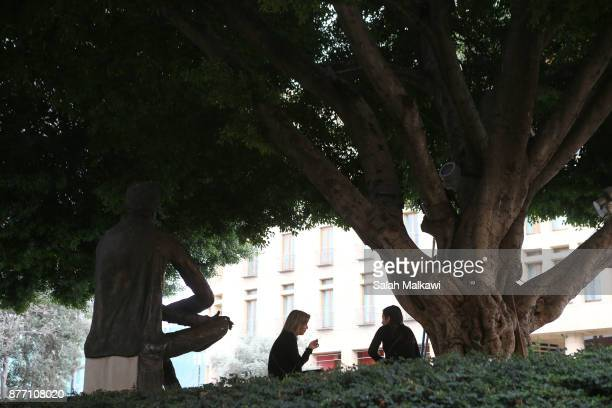 Women sit in a park in downtown Beirut Lebanon on Tuesday November 21 2017 Lebanon's prime minister Saad Hariri is expected to arrive early Wednesday...
