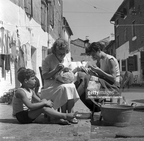 Women sit in the courtyard making lace Burano Venice 1949