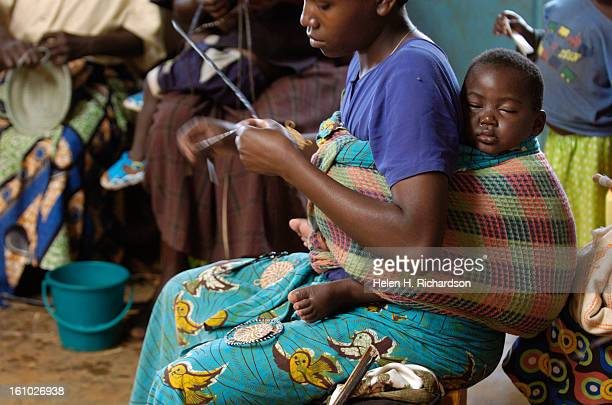 Women sit together and weave baskets fans pot holders and items in the weaving and handicraft shop They then sell the products for a profit giving...