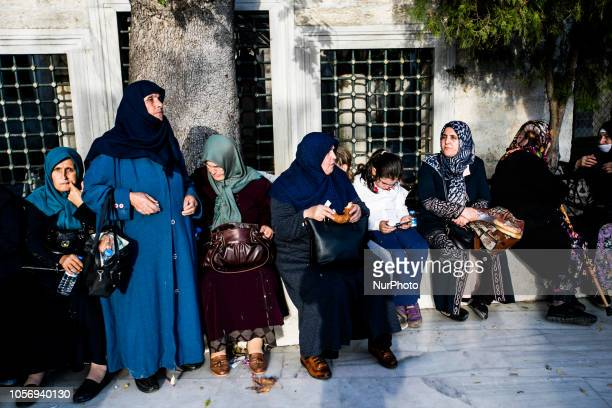 Women sits in front of the Eyup Sultan Mosque in Eyup Istanbul on