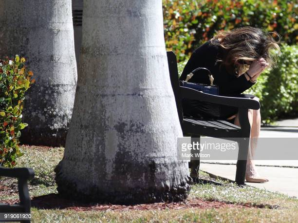 A women sits on a bench during the funeral service for Meadow Pollack at the Jewish congregation Kol Tikvah on February 16 2018 in Parkland Florida...