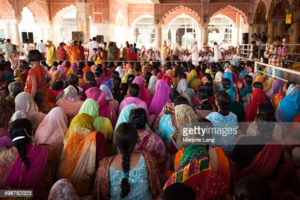 CONTENT] Women sitting and watching festivities for Holi festival at Krishna temple in Jaipur Rajasthan India