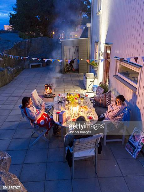 Women sitting at table on backyard