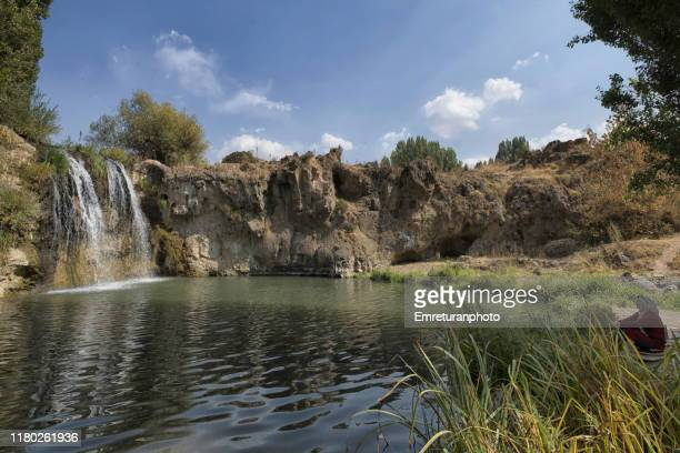 women sitting by a waterfall on muradiye river,van. - emreturanphoto stock pictures, royalty-free photos & images