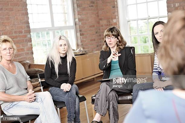 Women sitting in a circle for therapy