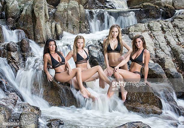 women sitting in a natural mountain stream spa, thailand - sensual massage stock photos and pictures