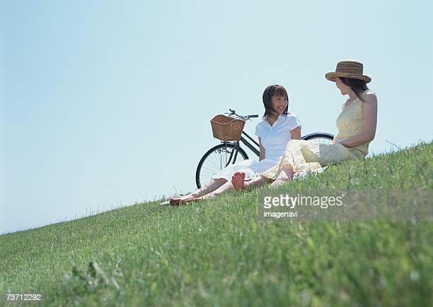Women sitting in field