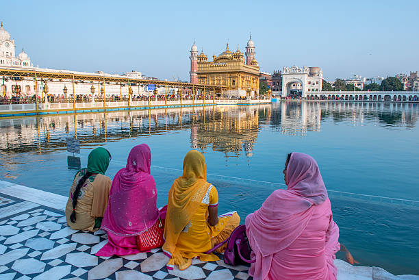 Women sitting in front of Golden Temple, Amritsar, India