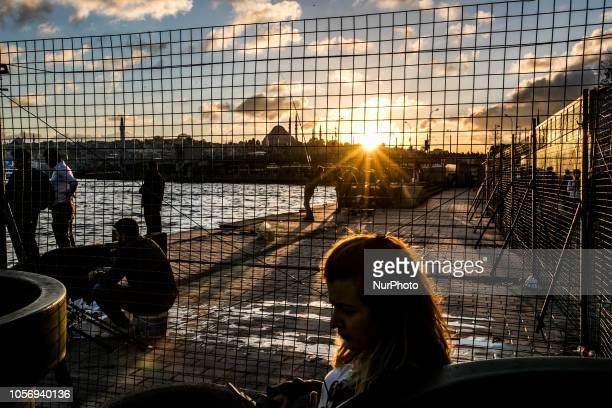 A women sitting near the Galata bridge in Karakoy Istanbul on