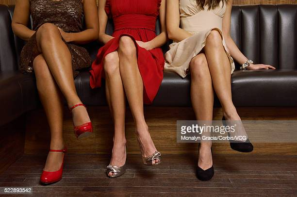 Women sitting on bench at nightclub