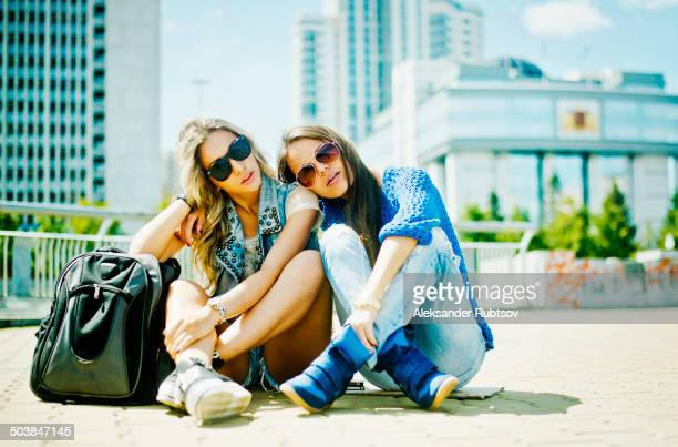 Women sitting on city street