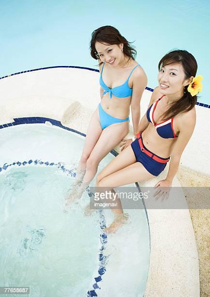 Women sitting on poolside