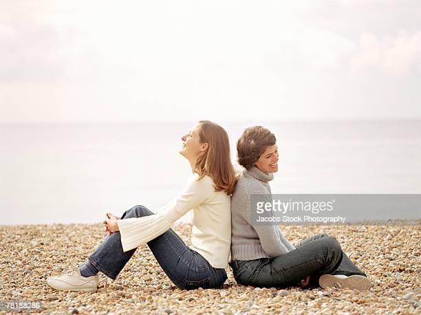 Women sitting on shore