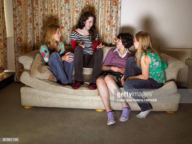 Women, sitting on sofa, gossiping