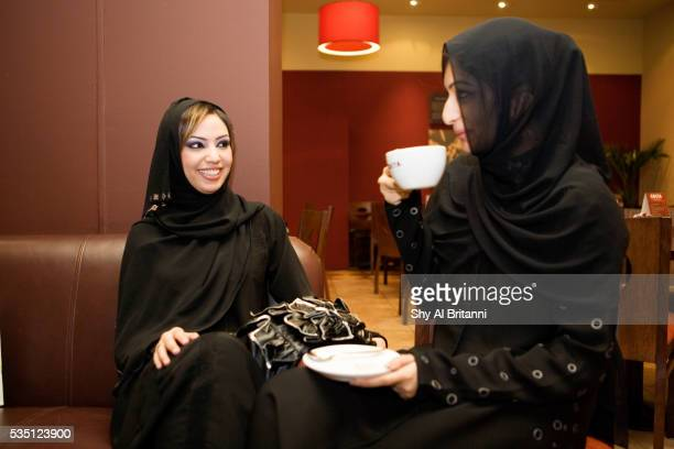 Women sitting together and chatting over a coffee, Dubai, UAE.