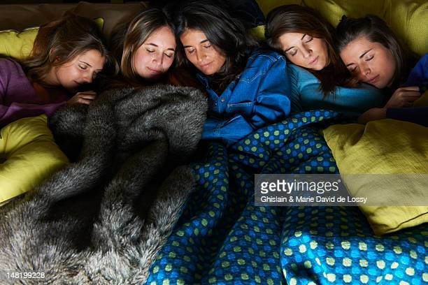 Women sleeping in bed together