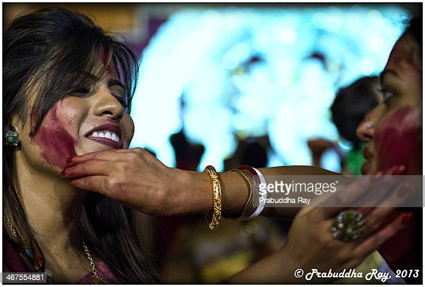 Women smear vermilion on each other during the last day of the Durga Puja Festival.