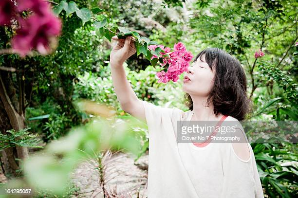 Women smell the flowers