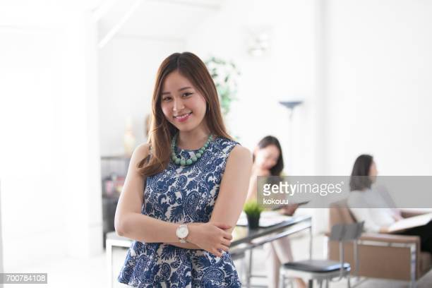 women smile at the office - sleeveless stock pictures, royalty-free photos & images