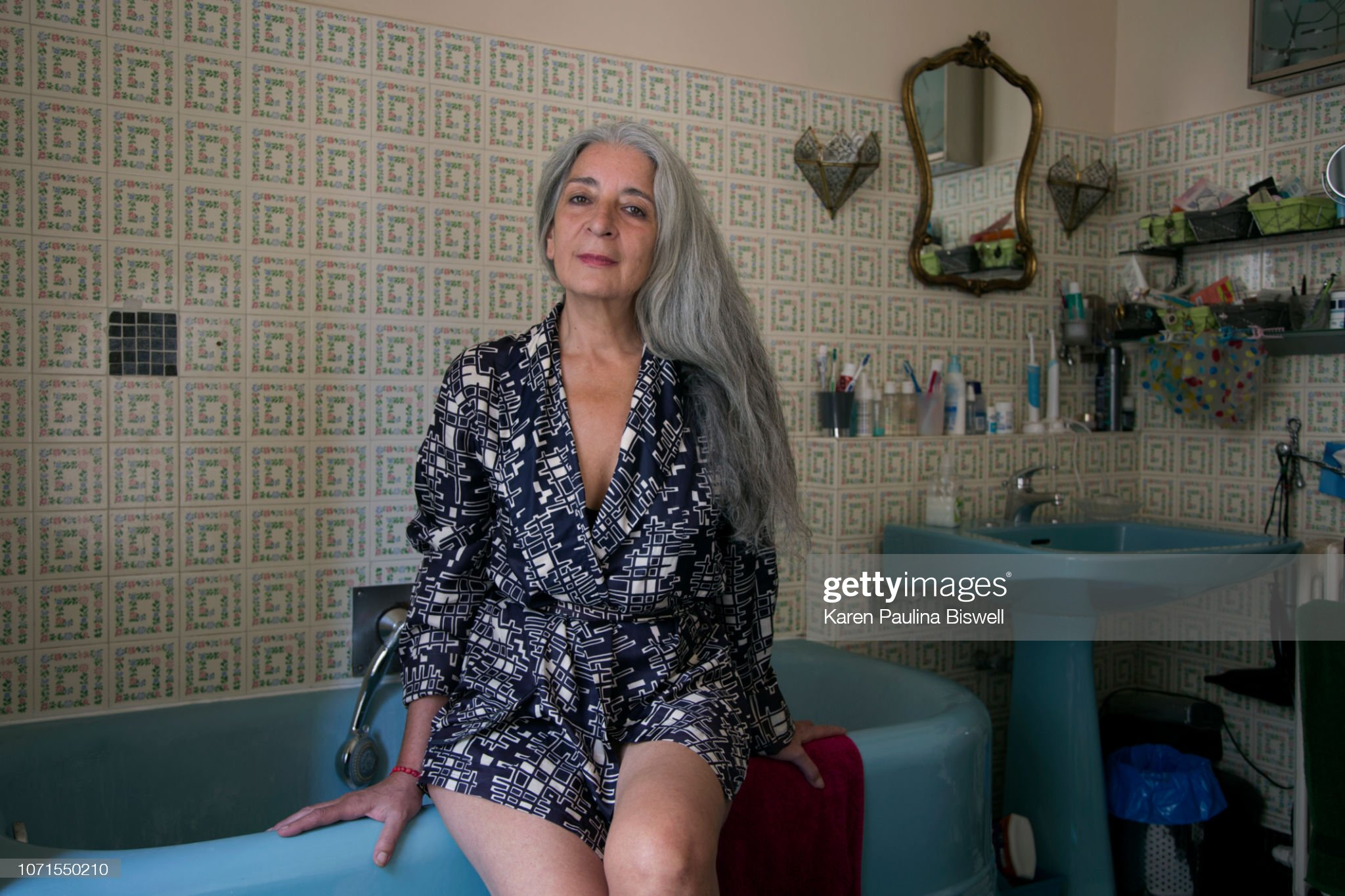 women smilimg in her bathroom : Stock Photo