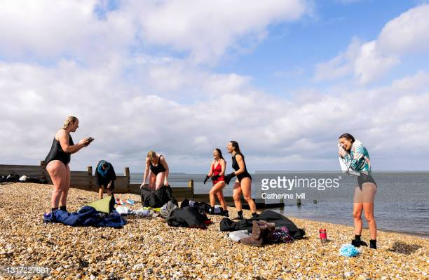 women smiling after open water swimming - menopossibilities stock pictures, royalty-free photos & images