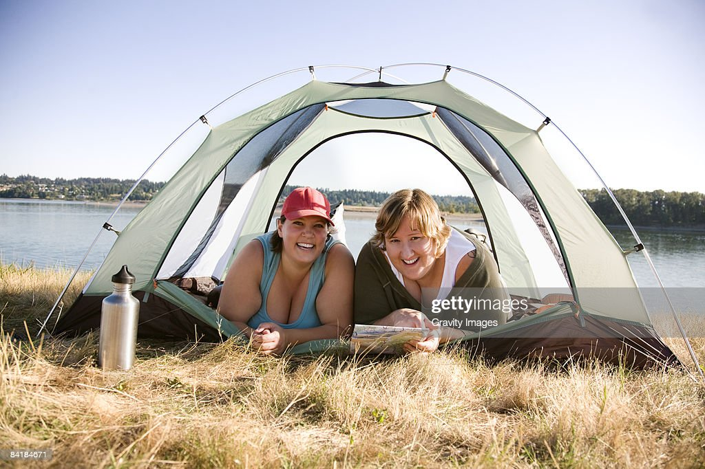Women Smiling and Laughing in Tent : Stock Photo