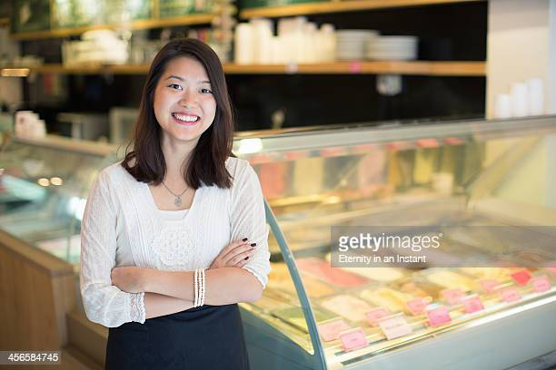 women smiling in ice cream shop. - ice cream parlour stock pictures, royalty-free photos & images