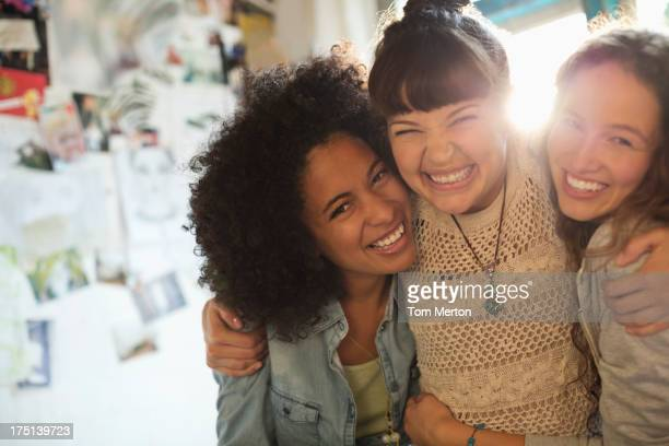 Women smiling together indoors