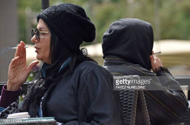 Women smoke publicly at a coffee shop in north Riyadh on January 25 2020 Like Western feminists of the early 20th century in an era of social change...