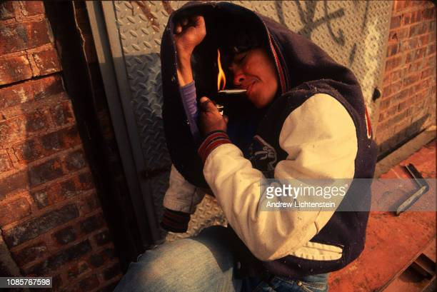 A women smokes crack cocaine April of 1991 on Troutman Street in the Bushwick neighborhood of Brooklyn During the early 1990's several streets in the...