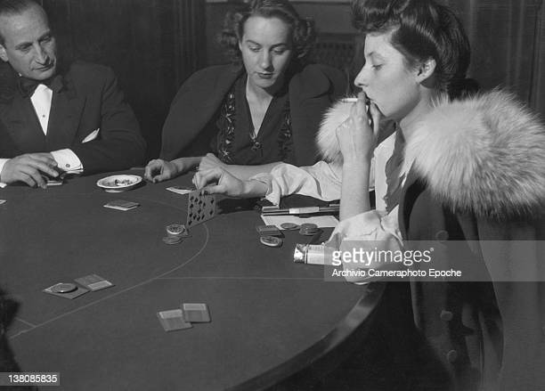 Women smoking and playing poker at the San Remo Casino 1950
