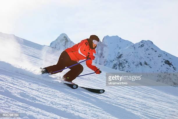 Women snow skier skiing on sunny ski resorts