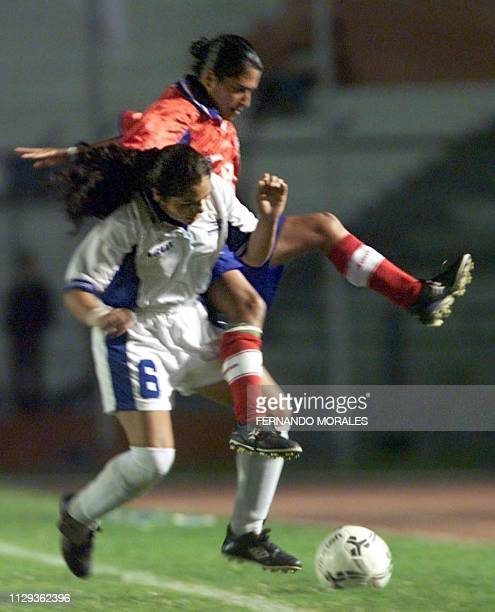 Women soccer players from Costa Rica Laura Levell and from Honduras Dania Acosta fight for the ball during a game in Guatemala City 01 December 2001...