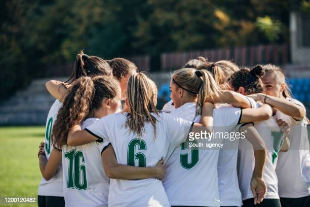 women soccer team celebrating victory - women's football stock pictures, royalty-free photos & images