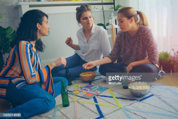 women socializing - game board stock photos and pictures