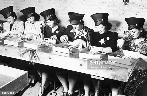 Women soldering radio chassis at Belmont Radio 1922 From left Lottie Frys Mildred Tessar Helen Carpenter Viola Davis Bernice Siwy and Dolly Chiero A...