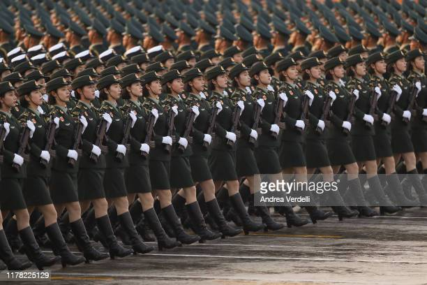Women soldiers of the People's Liberation Army rehearse the military parade early morning on October 01 in Tiananmen Square, Beijing, China. Today...