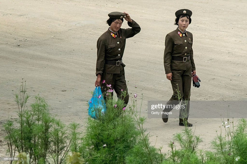 Women soldiers walks on street on August 24, 2015, North Korea. North and South Korea today came to an agreement to ease tensions following an exchange of artillery fire at the demilitarized border last week.