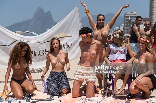 Women some without their bikini tops protest against a ban on topless at Ipanema beach in Rio de Janeiro Brazil on January 20 2015 AFP PHOTO /...