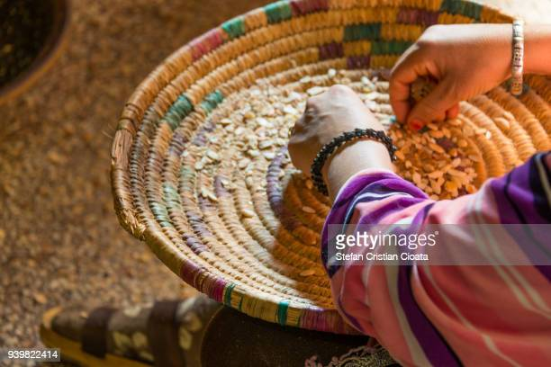 women sorting argan seeds in morocco, africa - black seed oil stock pictures, royalty-free photos & images