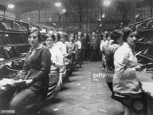 Women sorting mail at the post office during the Christmas rush circa 1920