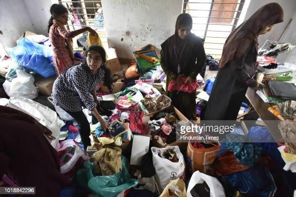 Women sorting out the relief material at a flood rescue camp at a school in Panadala on August 18 2018 in district Pathanamthitta India The flooding...