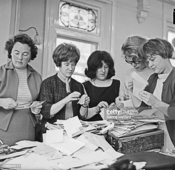 Women sorting post regarding the disaster in the coal mining village of Aberfan in Wales, UK, October 1966. The collapse of a spoil tip on 21st...